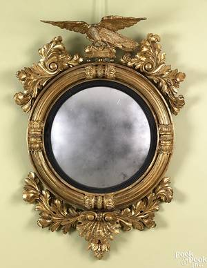 Carved giltwood convex mirror ca 1800