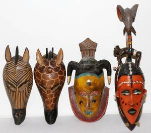 AFRICAN CARVED WOOD CEREMONIAL MASKS FOUR