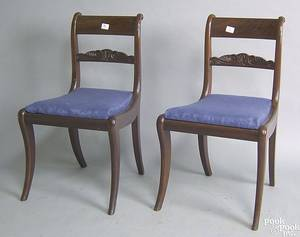 Pair of classical mahogany saber leg chairs