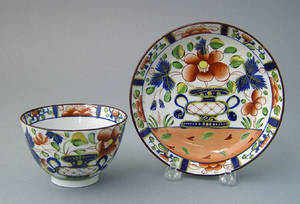 Gaudy Dutch urn cup and saucer