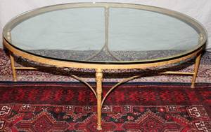 040110 GILT CAST IRON AND GLASS OVAL COFFEE TABLE