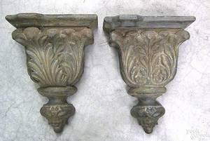 Pair of cast iron hanging wall brackets late 19thearly 20th c