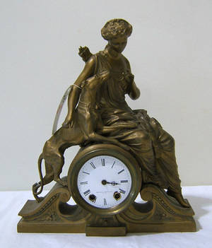 Seth Thomas gilt metal figural clock retailed by Mitchell Vance  Co