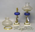 Pair of Pairpoint cobalt etched glass fluid lamps with etched shades