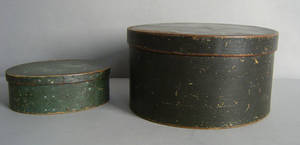 Two painted bentwood boxes