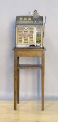 Pace Bantam Mint slot machine with an oak stand