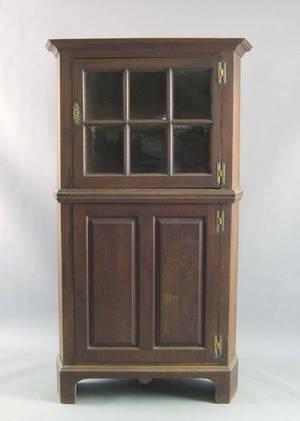 Pennsylvania walnut one piece corner cupboard with a glazed door