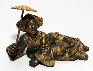 JAPANESE BRONZE FIGURE OF A RECLINING FEMALE