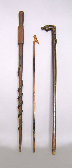 Three carved walking sticks