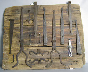 Mounted group of wrought iron hardware to include strap hinges