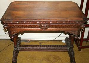 020372 BLACK FOREST CARVED OAK TRESTLE TABLE C 1930