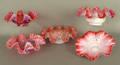 Five cranberry ruffled rim glass bowls