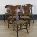 Six tiger maple saber leg dining chairs