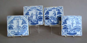 Four Delft blue and white allegorical tiles