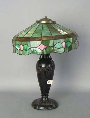 MoeBridges Co cast metal lamp with a later leaded glass shade Provenance The Estate of Anne Brossman Sweigart
