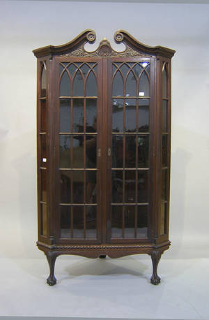 Chippendale style mahogany corner cupboard