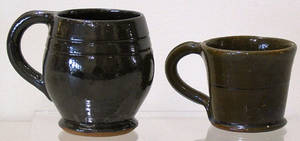 Two redware mugs by Thomas Stahl