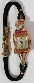 111171 BULOVA GOLD RUBY  DIAMOND LADYS WRISTWATCH