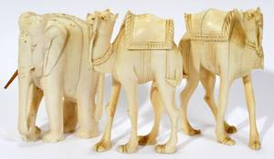 010083 CARVED IVORY ELEPHANT AND CAMELS 3 PCS H 3