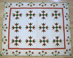 Pennsylvania applique quilt in a red and green tulip pattern