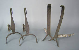 Two pairs of wrought iron fire dogs