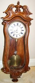 010313 CARVED WALNUT WALL CLOCK H 37 W 12
