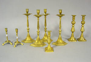 Nine reproduction brass candlesticks