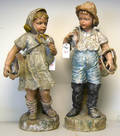 Pair of plaster of Paris figurines of a boy and girl