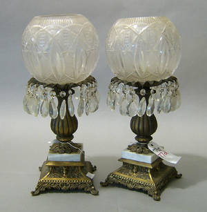 Pair of gilt metal table lamps with cut glass shades and prisms