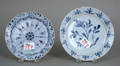 Two Delft blue and white plates