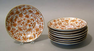 Eight Chinese export orange butterfly plates