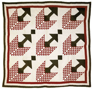 Red and green calico pieced Christmas tree quilt ca 1910