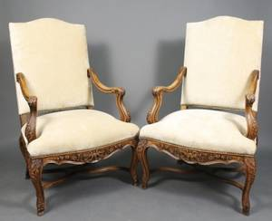 Pair of French Regence Style Walnut Fauteuils