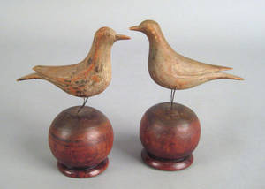 Pair of Pennsylvania carved and painted birds on stands late 19th c