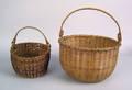 Two New England round splint baskets 19th c