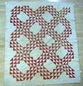 Three red and white pieced quilts