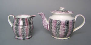 Purple and black rainbow spatter creamer and teapot 19th c