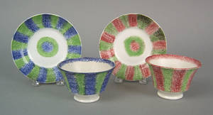 Two rainbow bullseye spatter cups and saucers 19th c