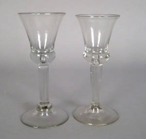Pair of blown colorless wine glasses late 18th c