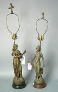 Pair of white metal figural table lamps