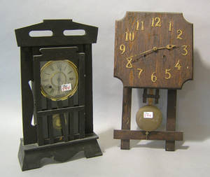 Two oak arts and crafts clocks