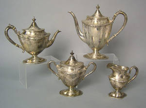 Four piece sterling silver tea service late 19th c