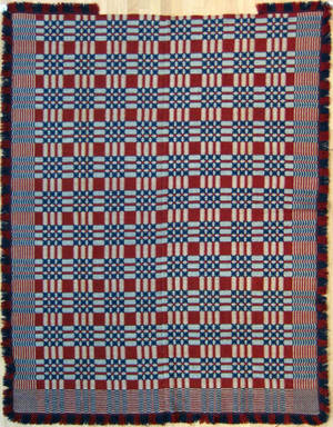 Red white and blue overshot geometric coverlet 19th c