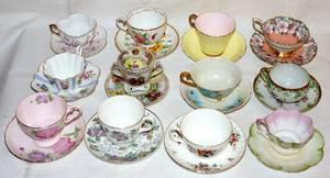 111504 PORCELAIN TEA CUPS  SAUCERS  POT DE CRME