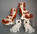 Two pairs of Staffordshire spaniels 19th c