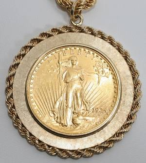 041156 US GOLD COIN IN A 14KT MOUNT DIA 1 78