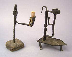 Two wrought iron rush light and candleholders 19th c
