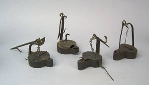 Four wrought iron betty lamps 18th19th c