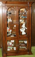 050175 CARVED WOOD  BEVELED GLASS CURIO CABINETS