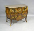 Pair of French style marble top commodes